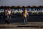 Spain feels pinch as cash-strapped tourists stay away